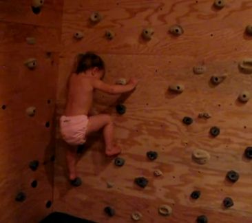 22-Month-Old Toddler bouldering up a homemade climbing wall