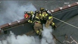 Firefighters Narrowly Escape Roof Collapse