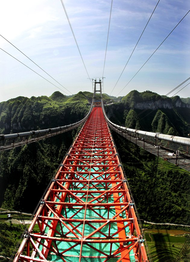 The Highest and Longest Valley Suspension Bridge in the world opens in China (Video)
