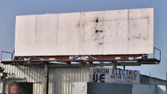 millionaire's billboard plea removed
